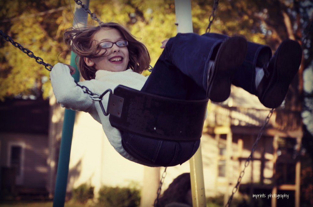 Girl on swing in fall by Katie M. Reid Photogprahy