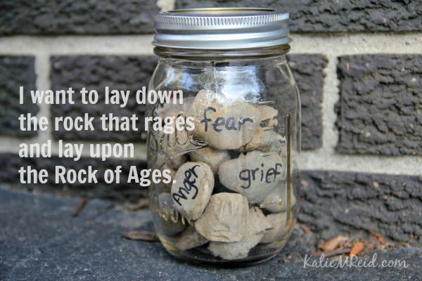 Lay down the rock that rages and lay upon the Rock of Ages by Katie M Reid