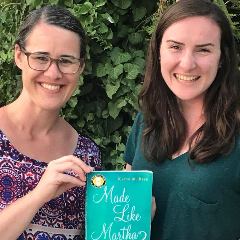 Katie and Kaitlyn book launch manager with Made Like Martha outside